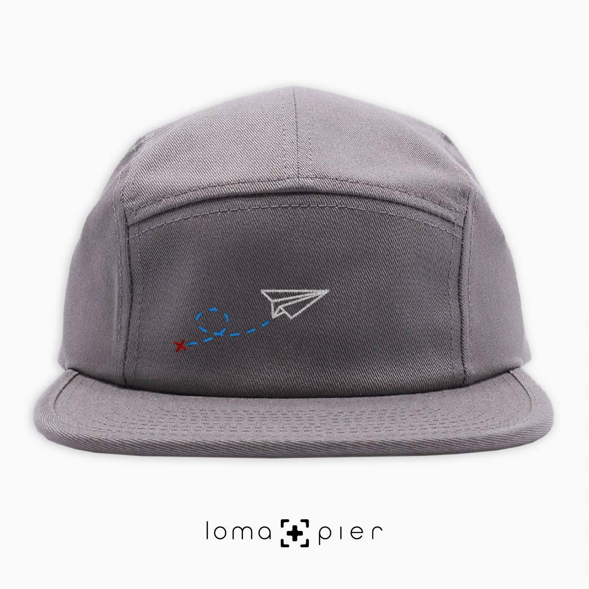 PAPER AIRPLANE icon embroidered on a grey cotton 5-panel hat by loma+pier hat store