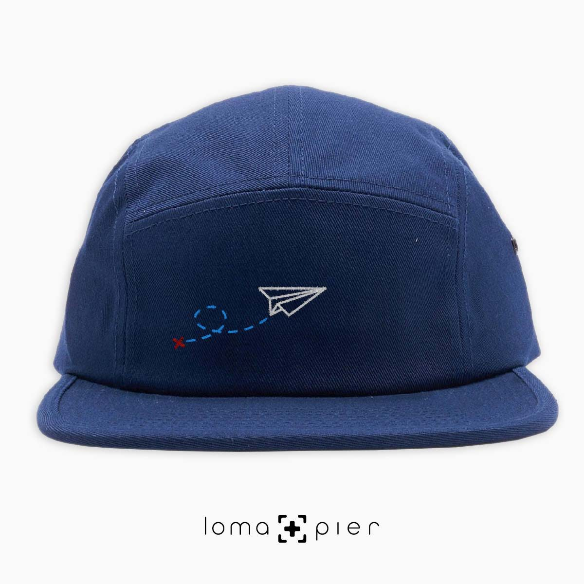 PAPER AIRPLANE icon embroidered on a navy blue cotton 5-panel hat by loma+pier hat store