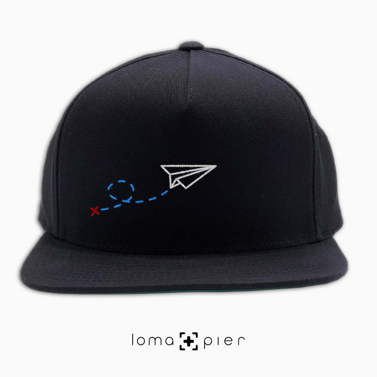 PAPER AIRPLANE icon embroidered on a black classic snapback hat by loma+pier hat store