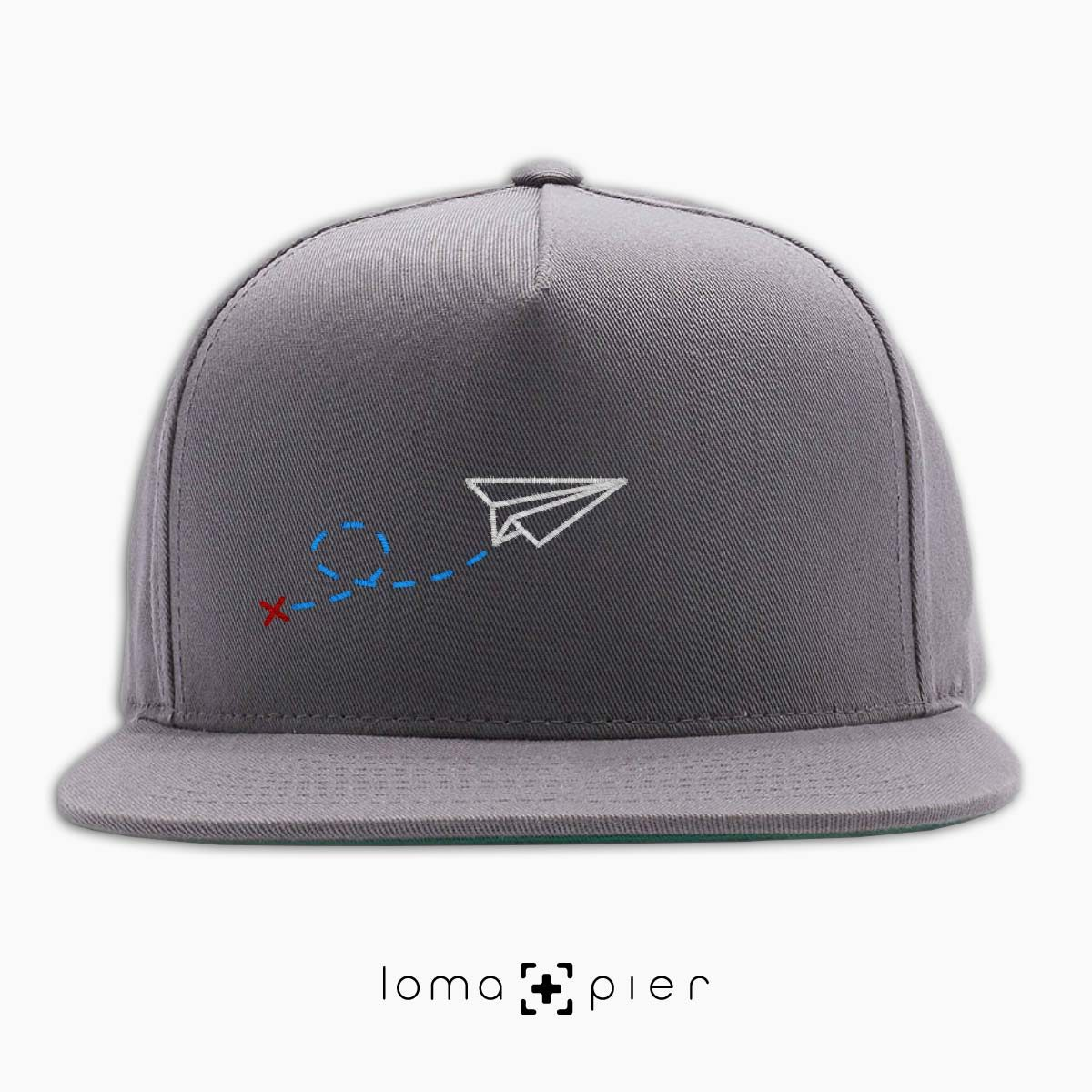 PAPER AIRPLANE icon embroidered on a grey classic snapback hat by loma+pier hat store