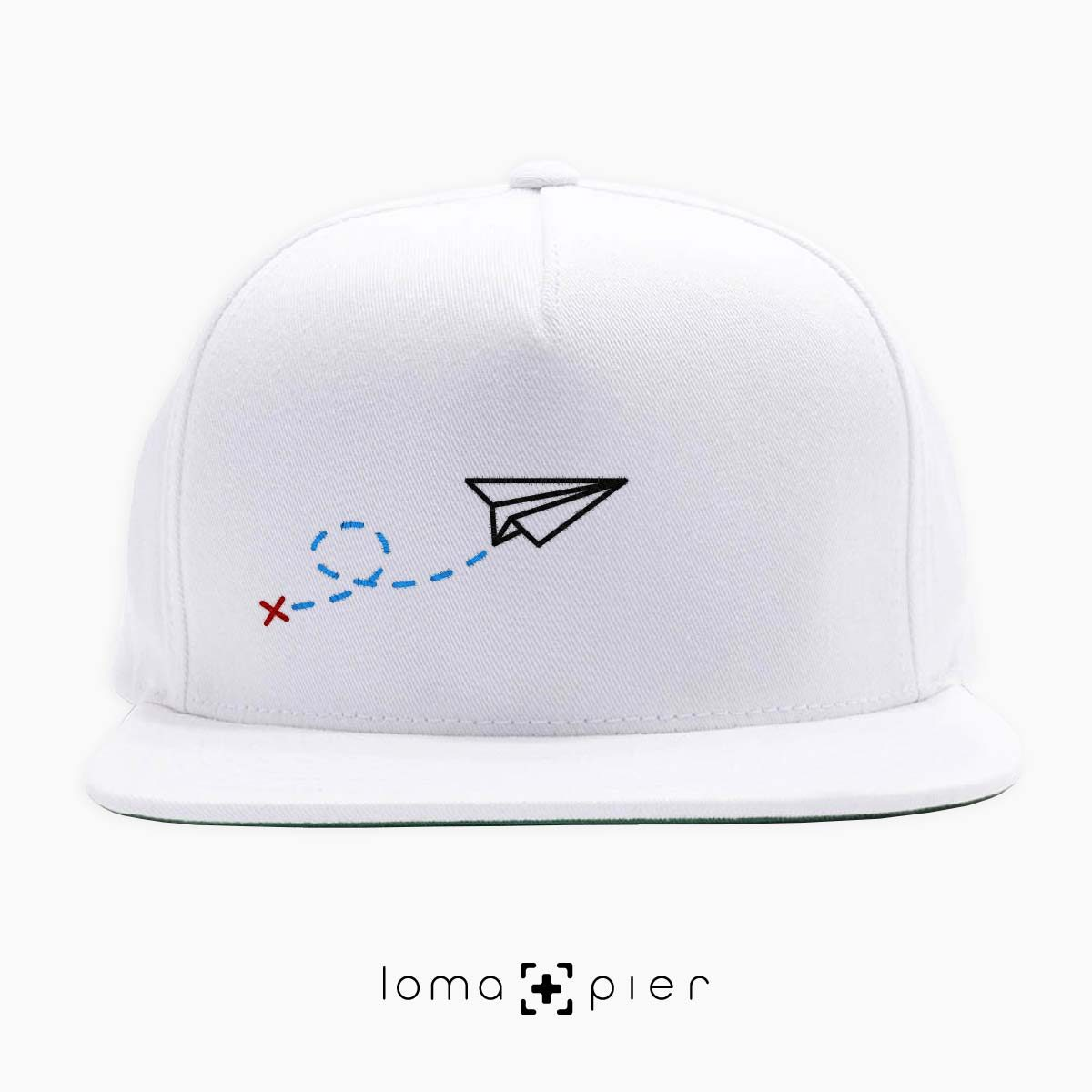 PAPER AIRPLANE icon embroidered on a white classic snapback hat by loma+pier hat store