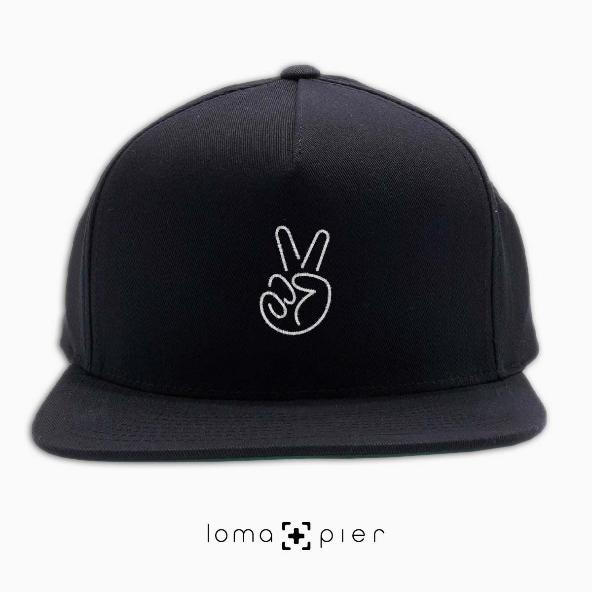 PEACE HAND icon embroidered on a black classic snapback hat with white thread by loma+pier hat store