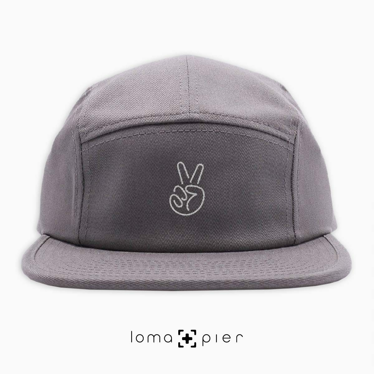 PEACE HAND icon embroidered on a grey cotton 5-panel hat with white thread by loma+pier hat store