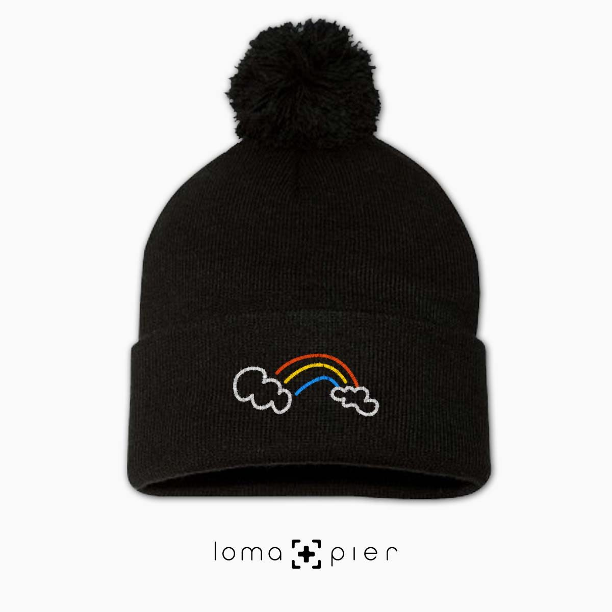 RAINBOW icon embroidered on a black pom pom beanie with multicolor thread by loma+pier hat store