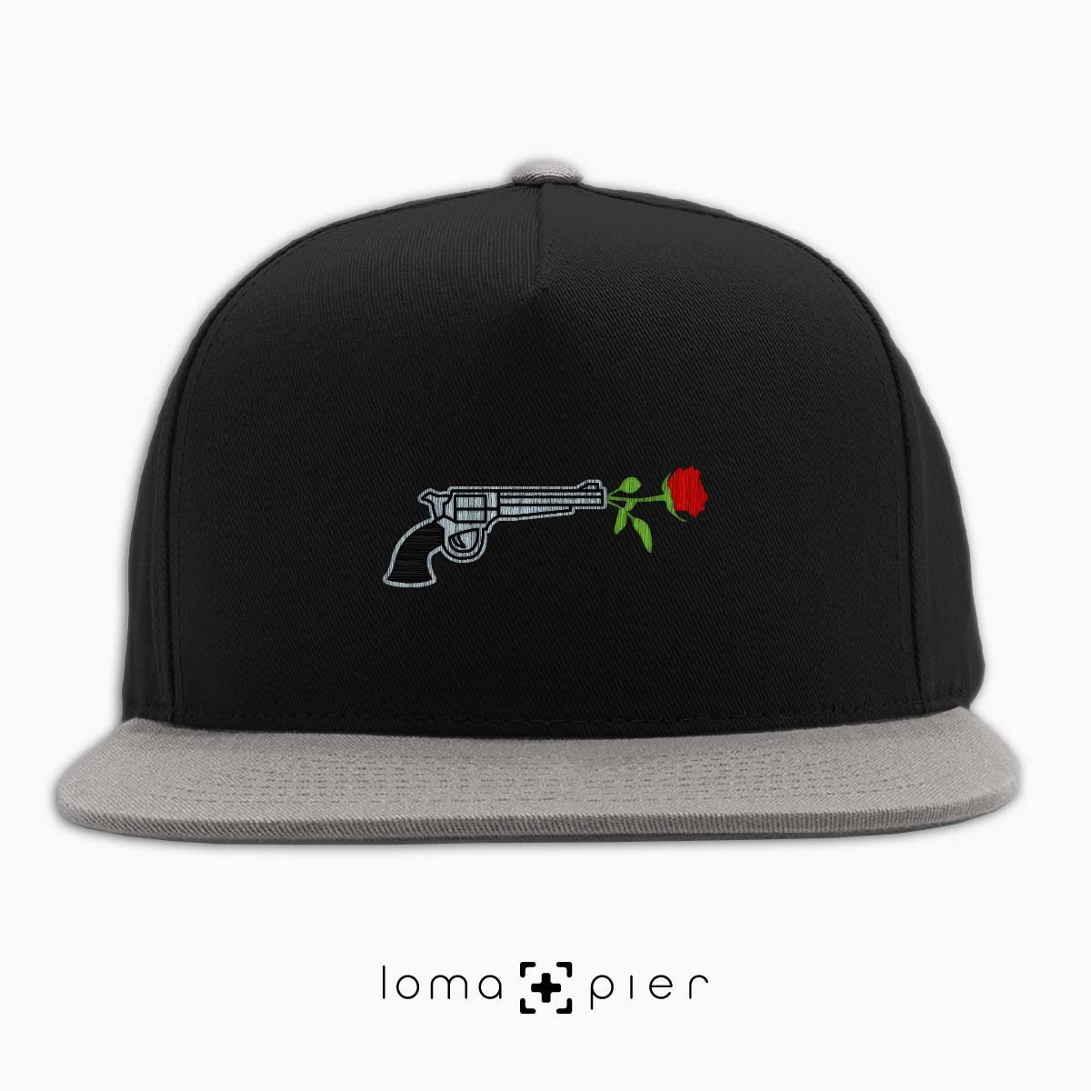 ROSE REVOLVER icon embroidered on a black and grey classic snapback hat with multicolor thread by loma+pier hat store