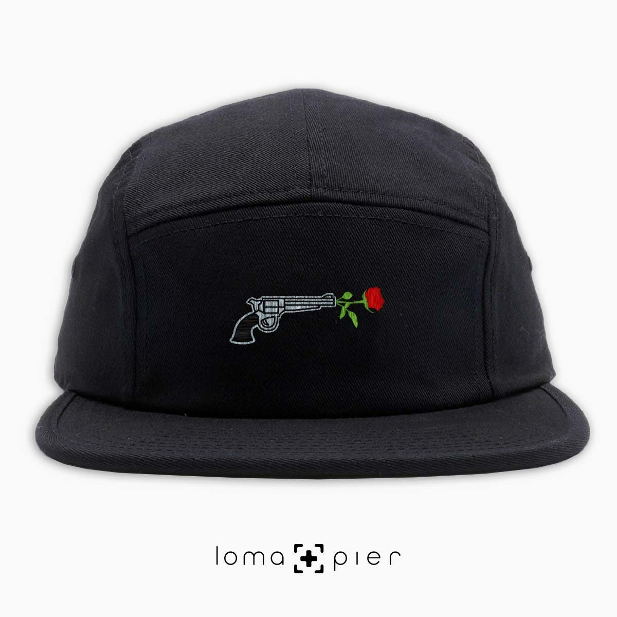 ROSE REVOLVER icon embroidered on a black cotton 5-panel hat with multicolor thread by loma+pier hat store