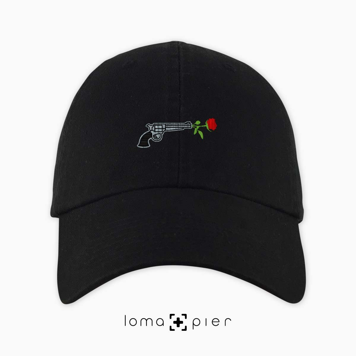 ROSE REVOLVER icon embroidered on a black unstructured dad hat with multicolor thread by loma+pier hat store made in the USA
