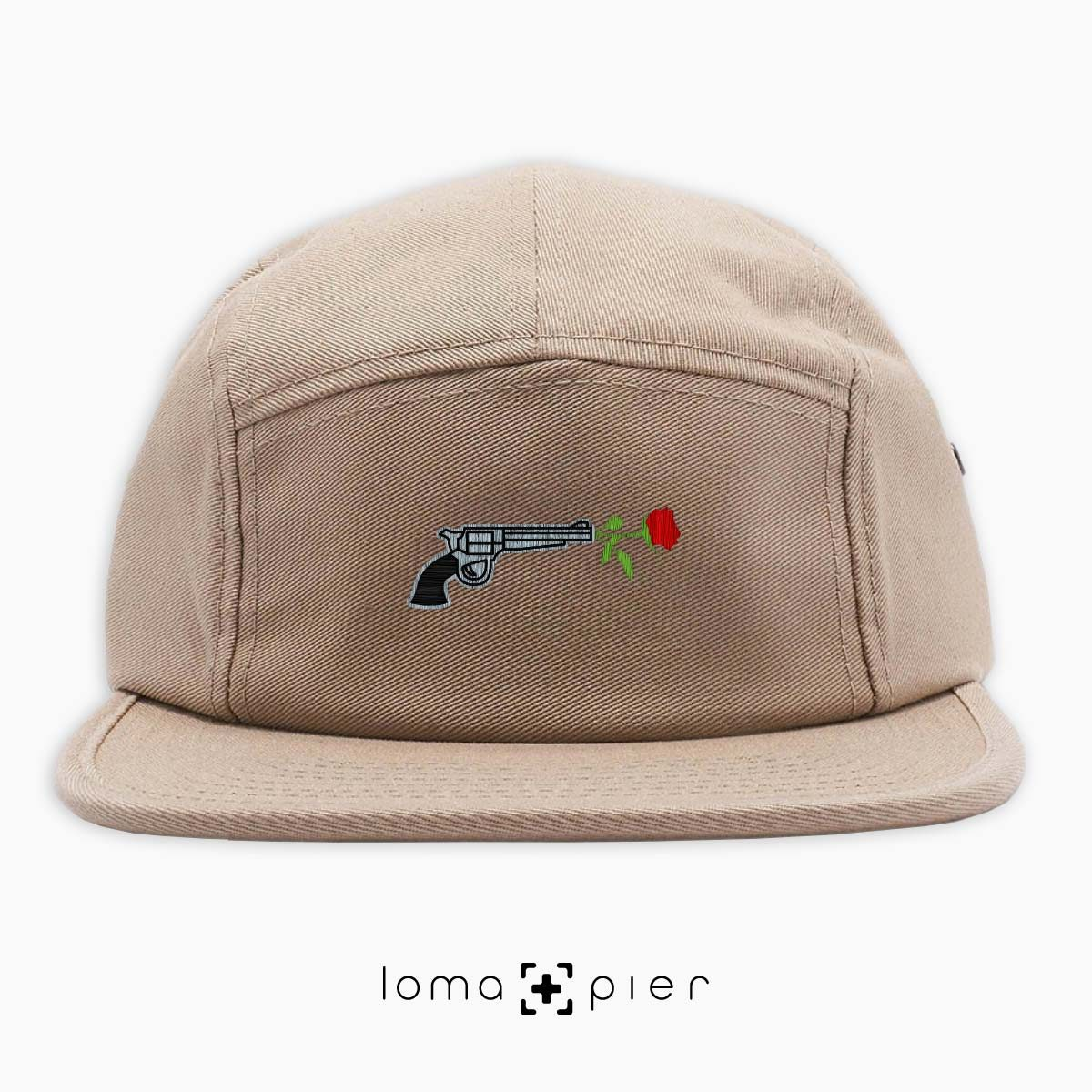 ROSE REVOLVER icon embroidered on a khaki cotton 5-panel hat with multicolor thread by loma+pier hat store