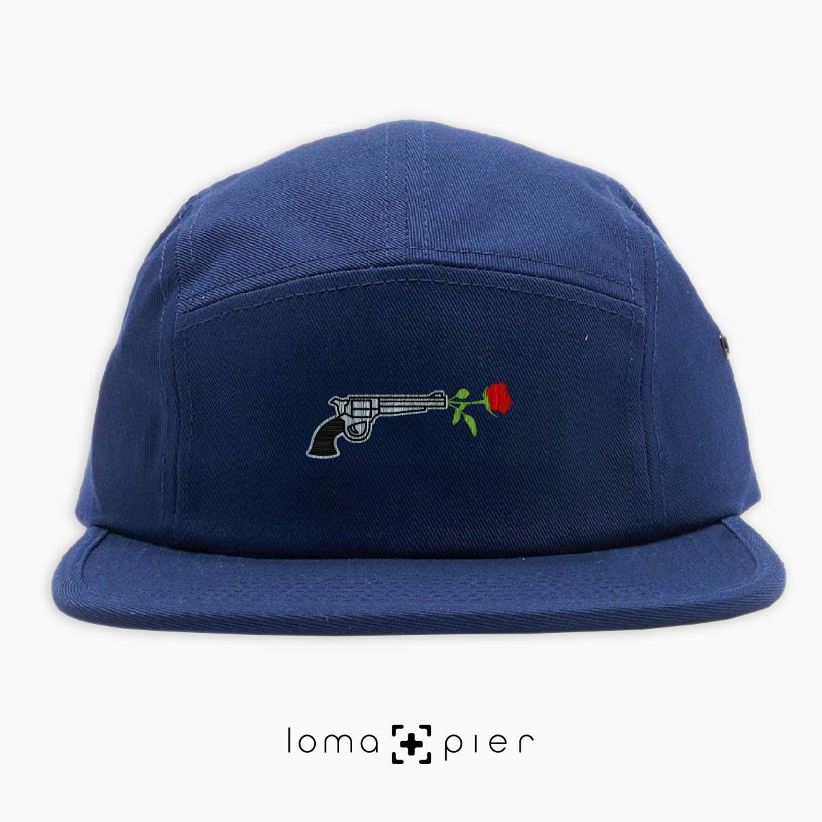 ROSE REVOLVER icon embroidered on a navy blue cotton 5-panel hat with multicolor thread by loma+pier hat store