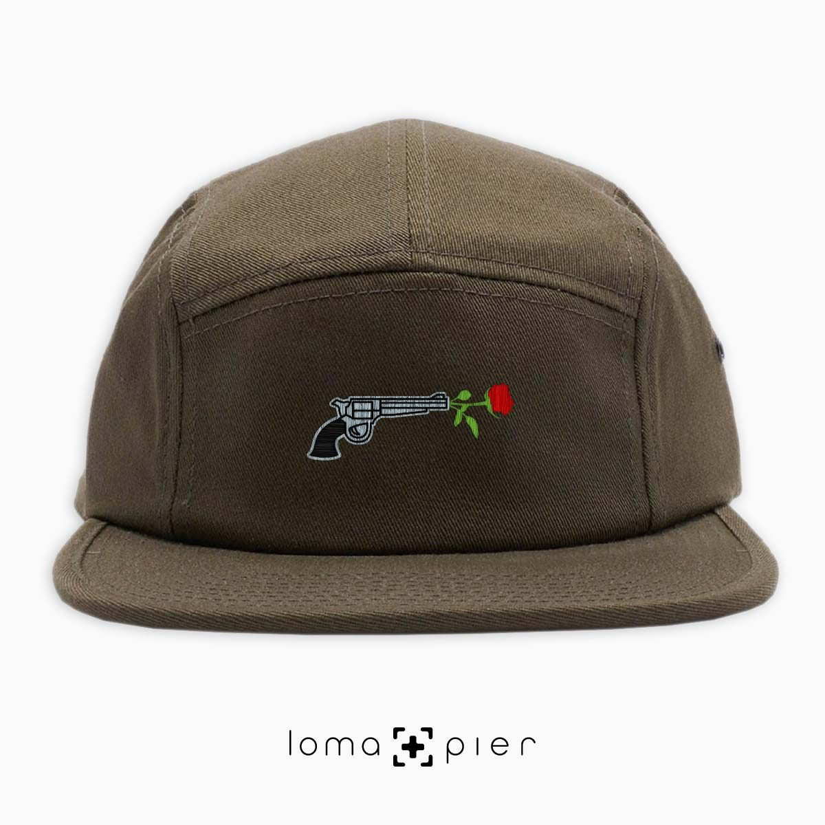 ROSE REVOLVER icon embroidered on an olive green cotton 5-panel hat with multicolor thread by loma+pier hat store