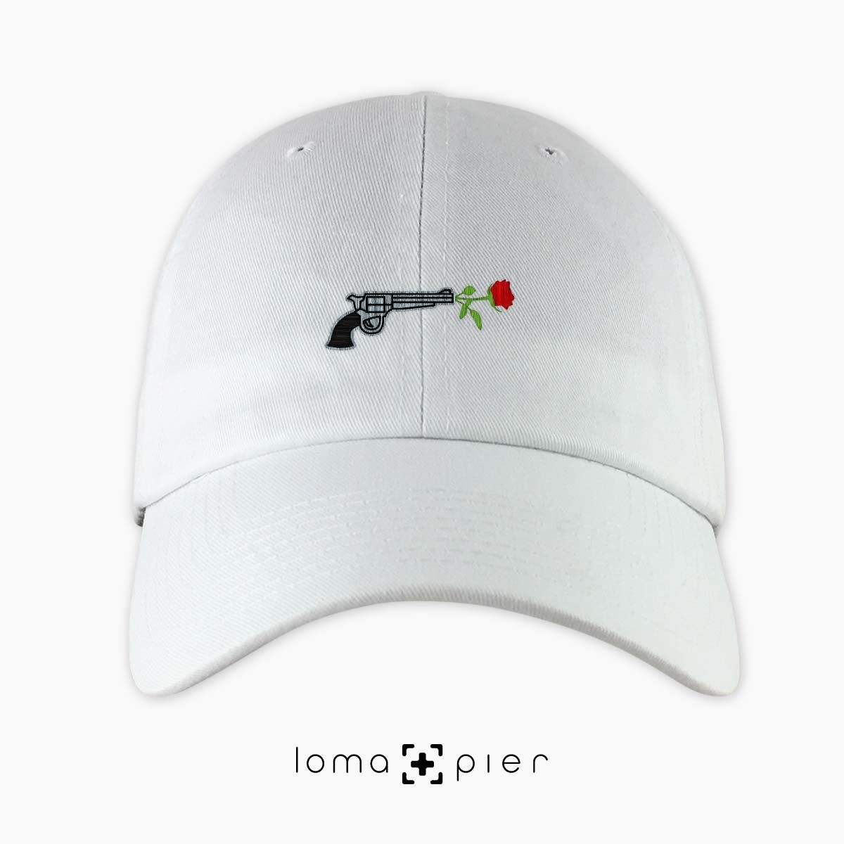 ROSE REVOLVER icon embroidered on a white unstructured dad hat with multicolor thread by loma+pier hat store made in the USA
