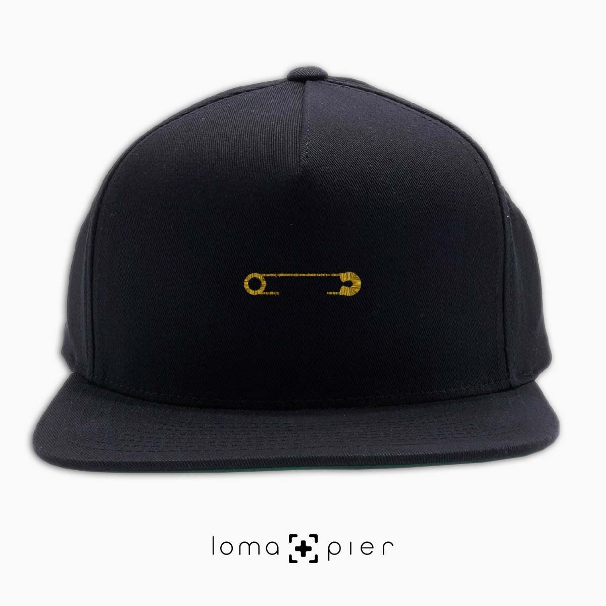 SAFETY PIN icon embroidered on a black classic snapback with gold thread by loma+pier hat store