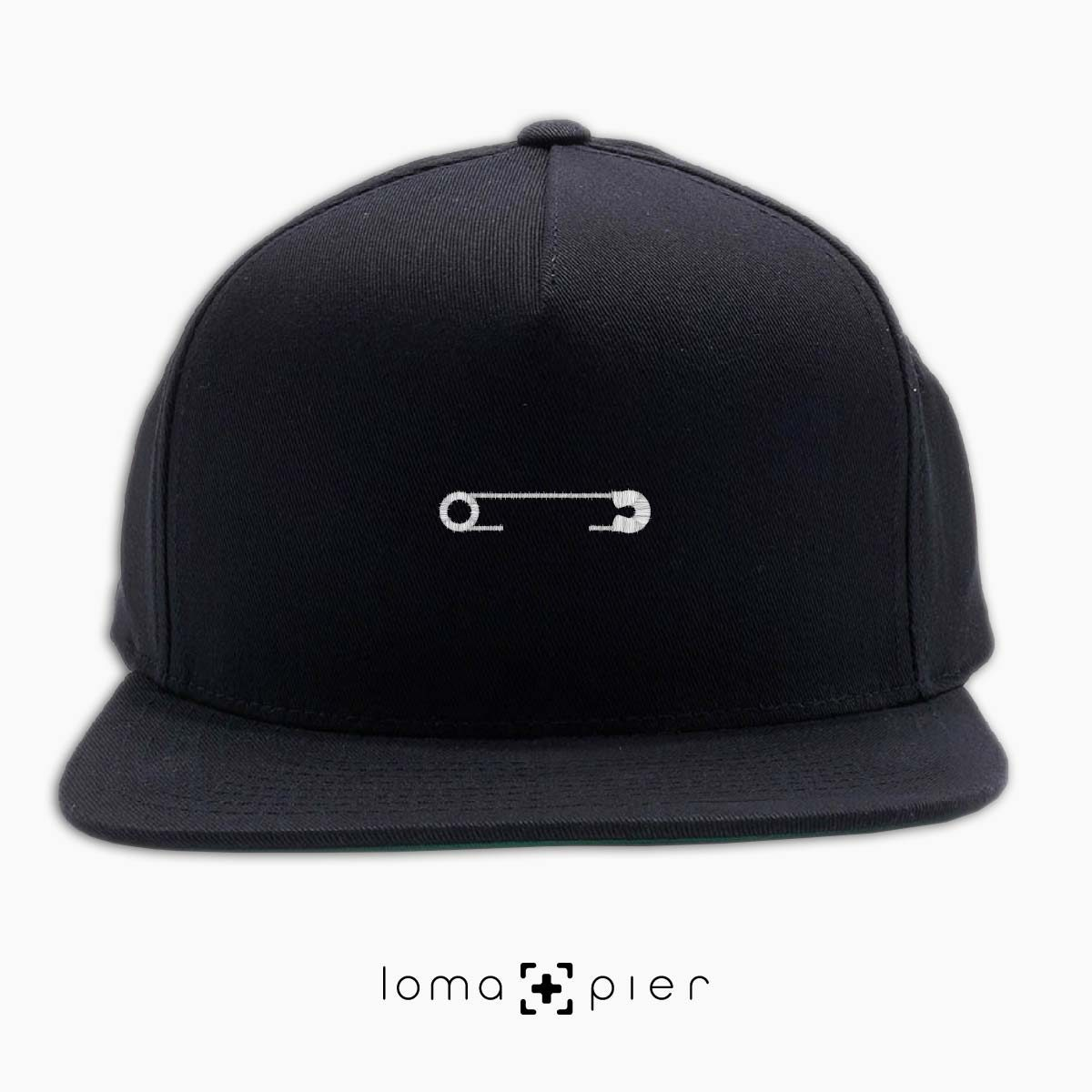 SAFETY PIN icon embroidered on a black classic snapback with white thread by loma+pier hat store