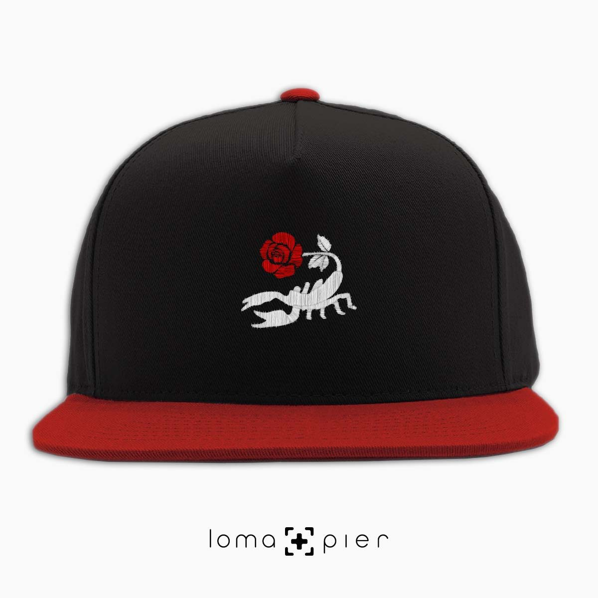 SCORPION ROSE icon embroidered on a black and red classic snapback hat with multicolor thread by loma+pier hat store