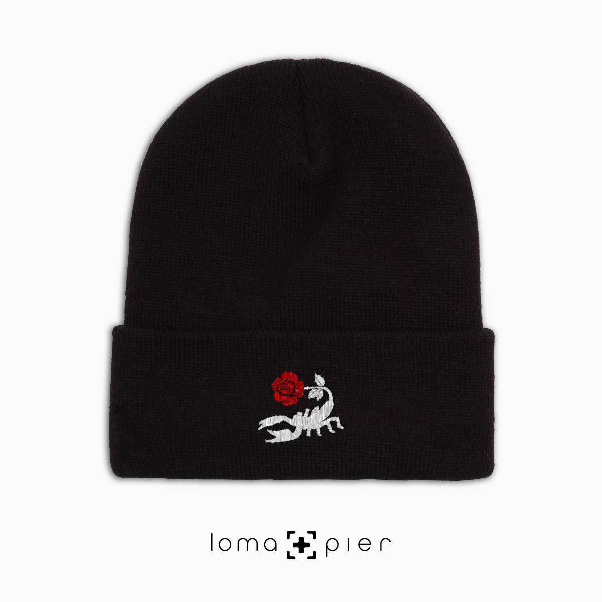 SCORPION ROSE icon embroidered on a black cuffed beanie with multicolor thread by loma+pier hat store made in the USA