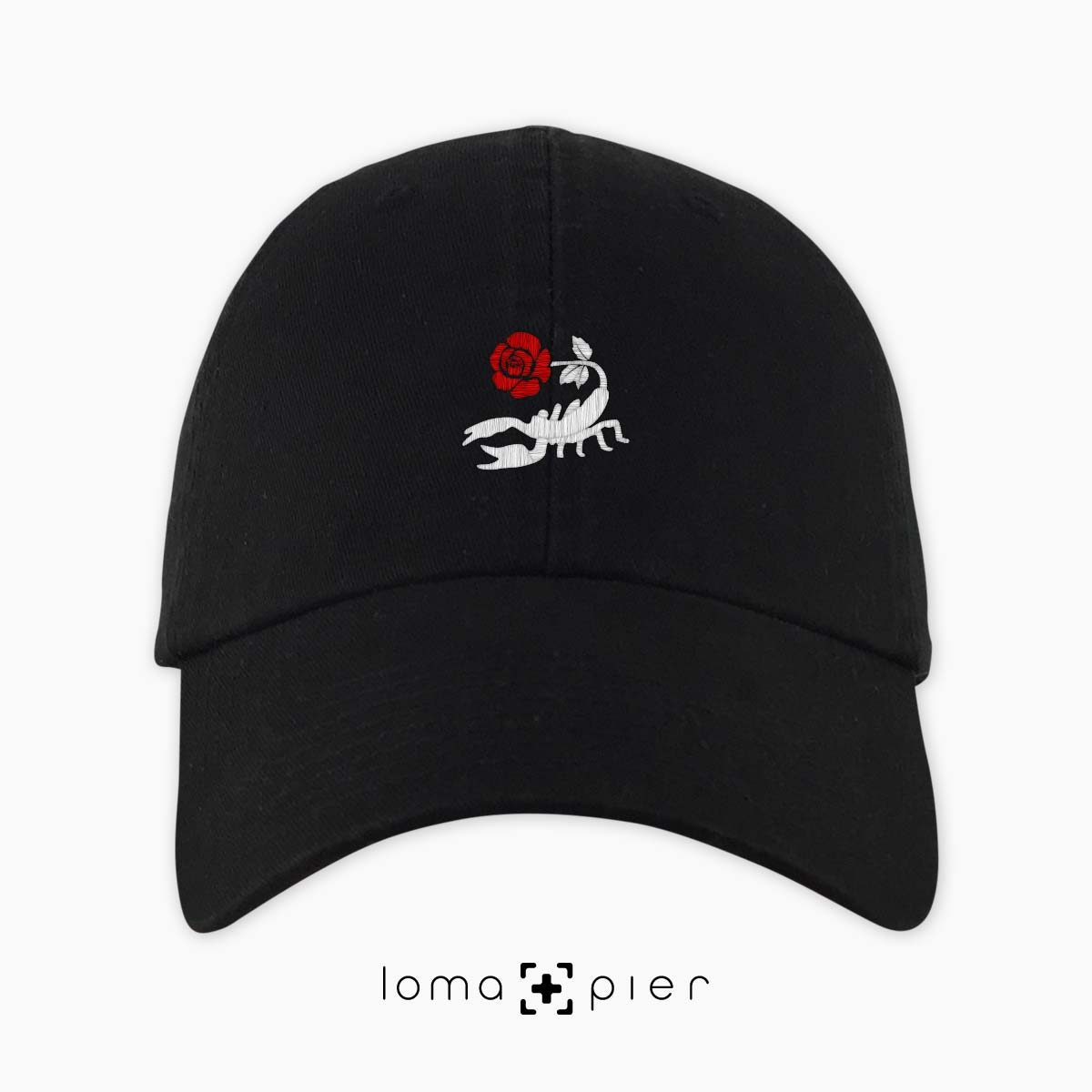 SCORPION ROSE icon embroidered on a black unstructured dad hat with red and white thread by loma+pier hat store made in the USA