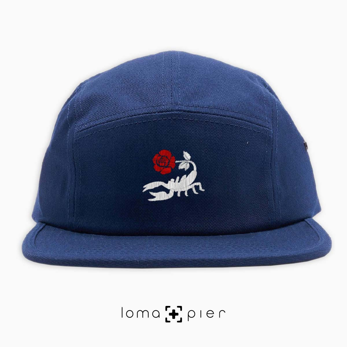 SCORPION ROSE icon embroidered on a navy blue cotton 5-panel hat with multicolor thread in the loma+pier hat store