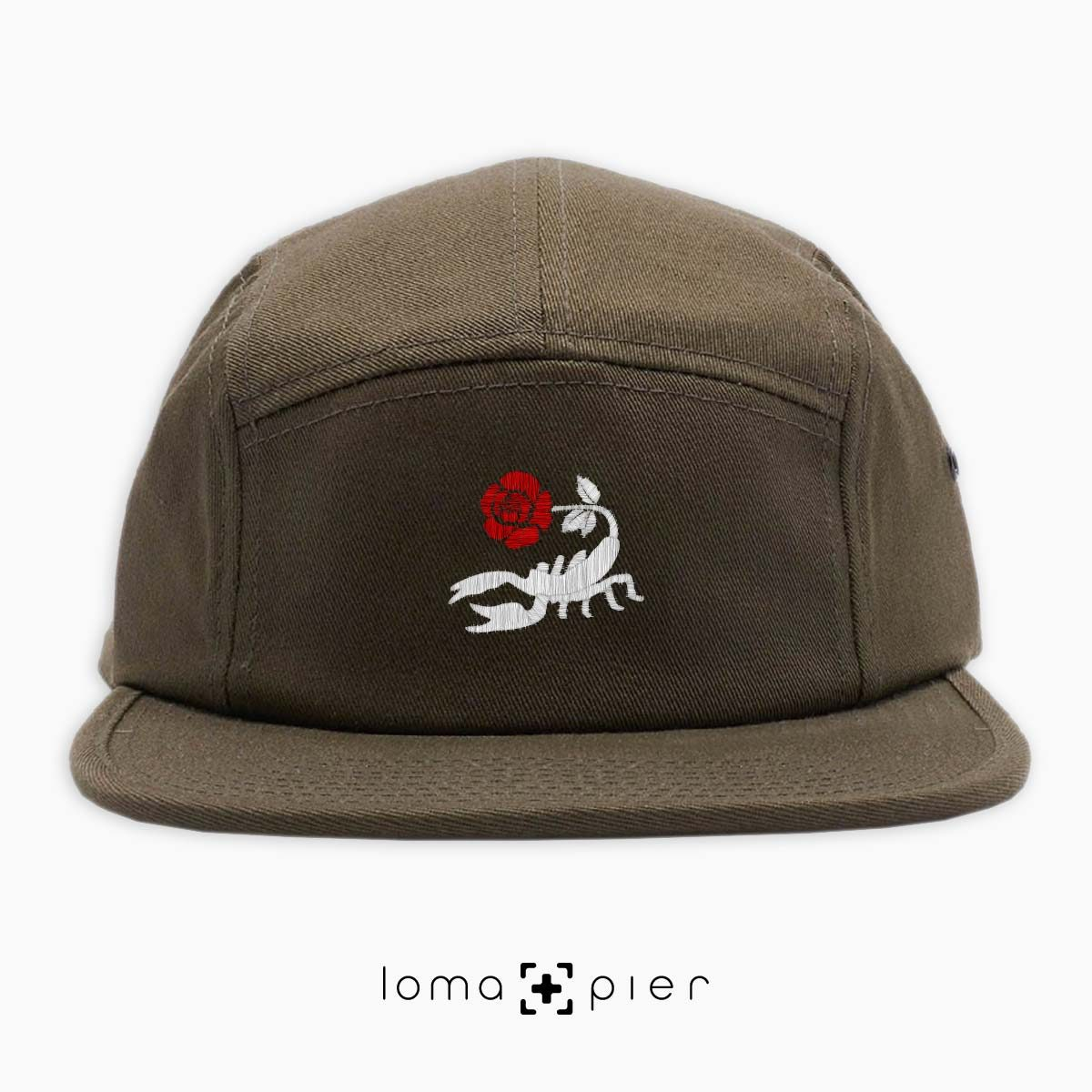 SCORPION ROSE icon embroidered on an olive green cotton 5-panel hat with multicolor thread in the loma+pier hat store