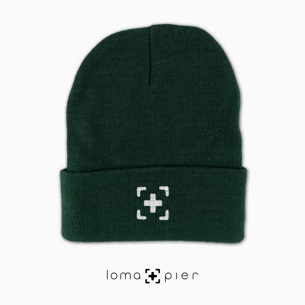 soft beanie cap with icon in green by loma+pier hat store