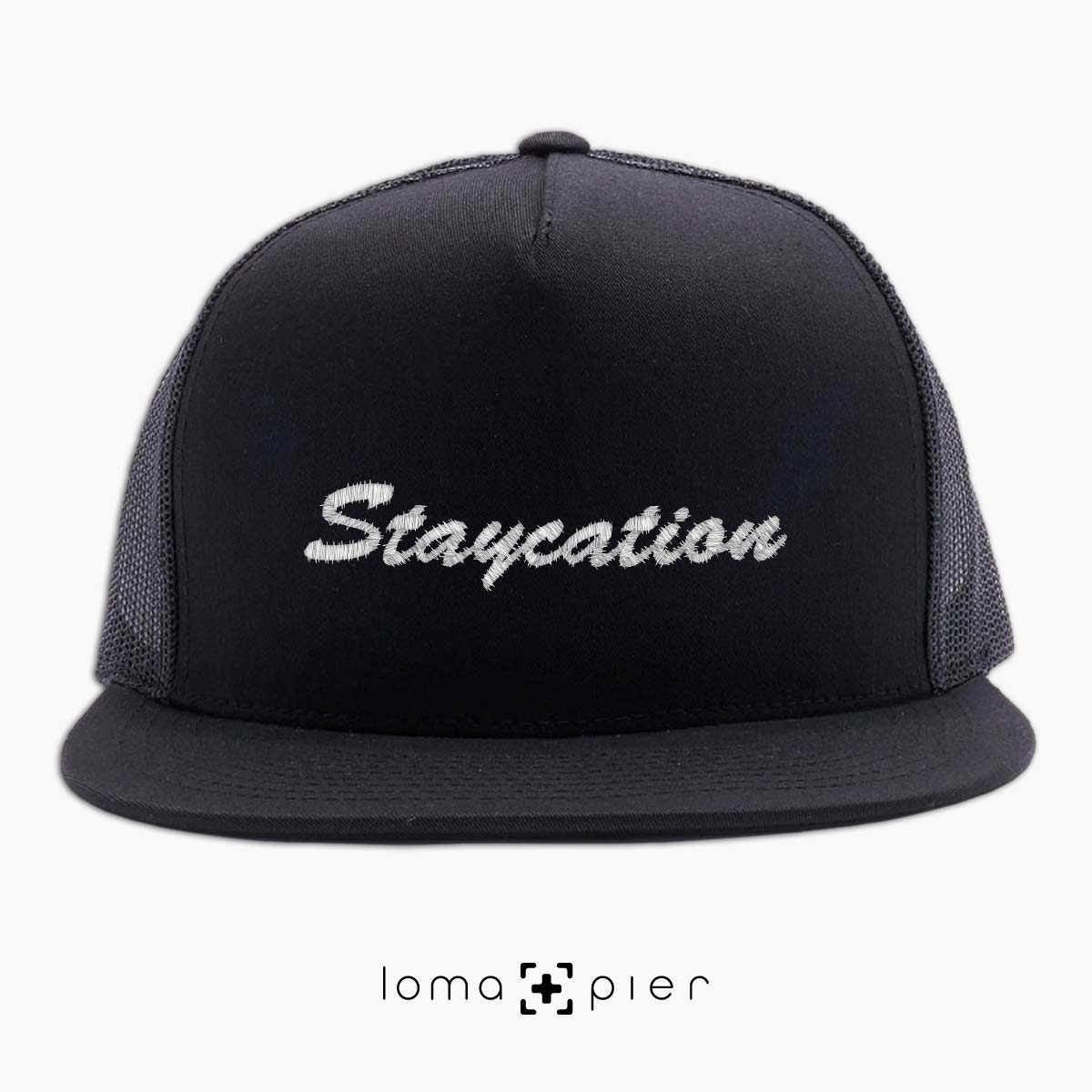 STAYCATION embroidered on a black beach netback trucker by loma+pier hat store