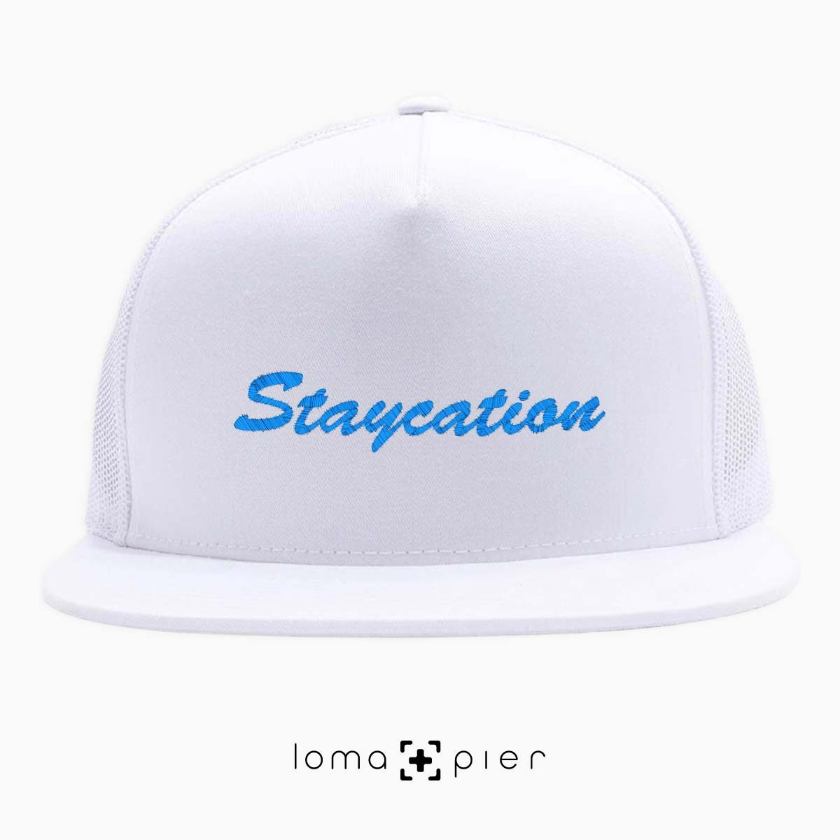 STAYCATION embroidered on a white beach netback trucker by loma+pier hat store