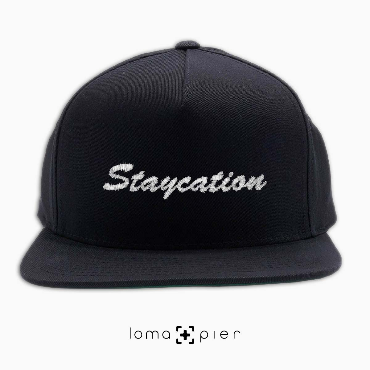 STAYCATION introvert saying embroidered on a black classic snapback hat with white thread by loma+pier hat store