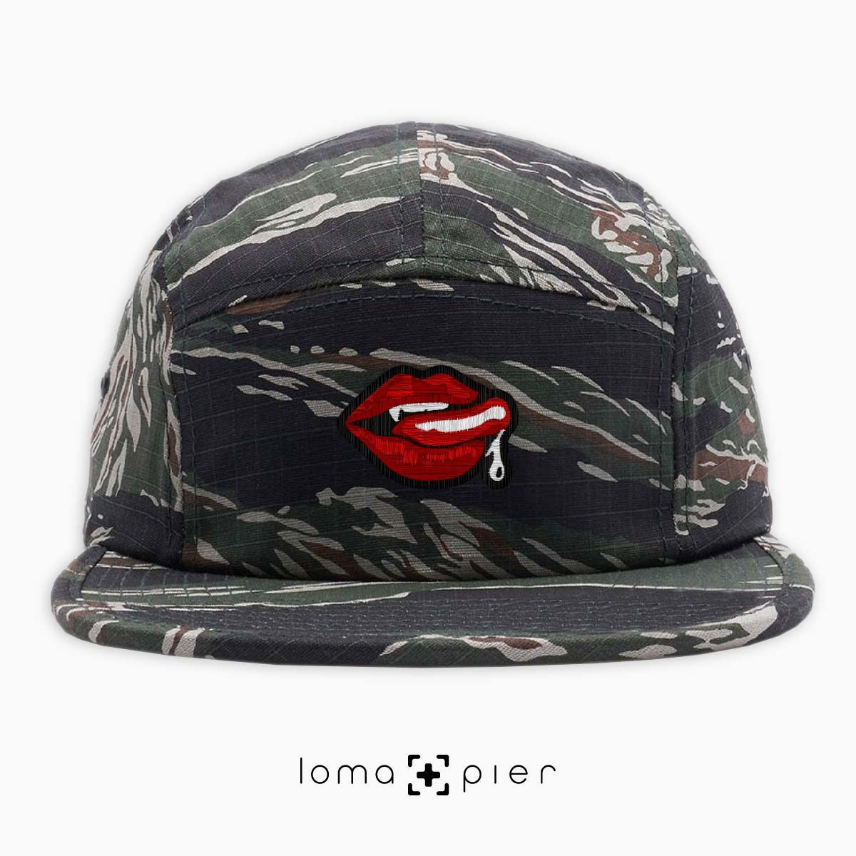 SUCCUBUS icon embroidered on a camo cotton 5-panel hat with multicolor thread by loma+pier hat store