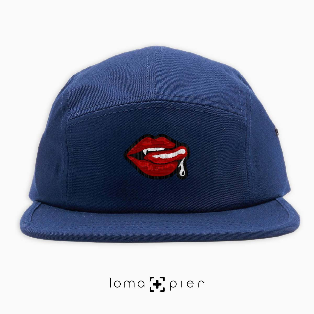 SUCCUBUS icon embroidered on a navy blue cotton 5-panel hat with multicolor thread by loma+pier hat store