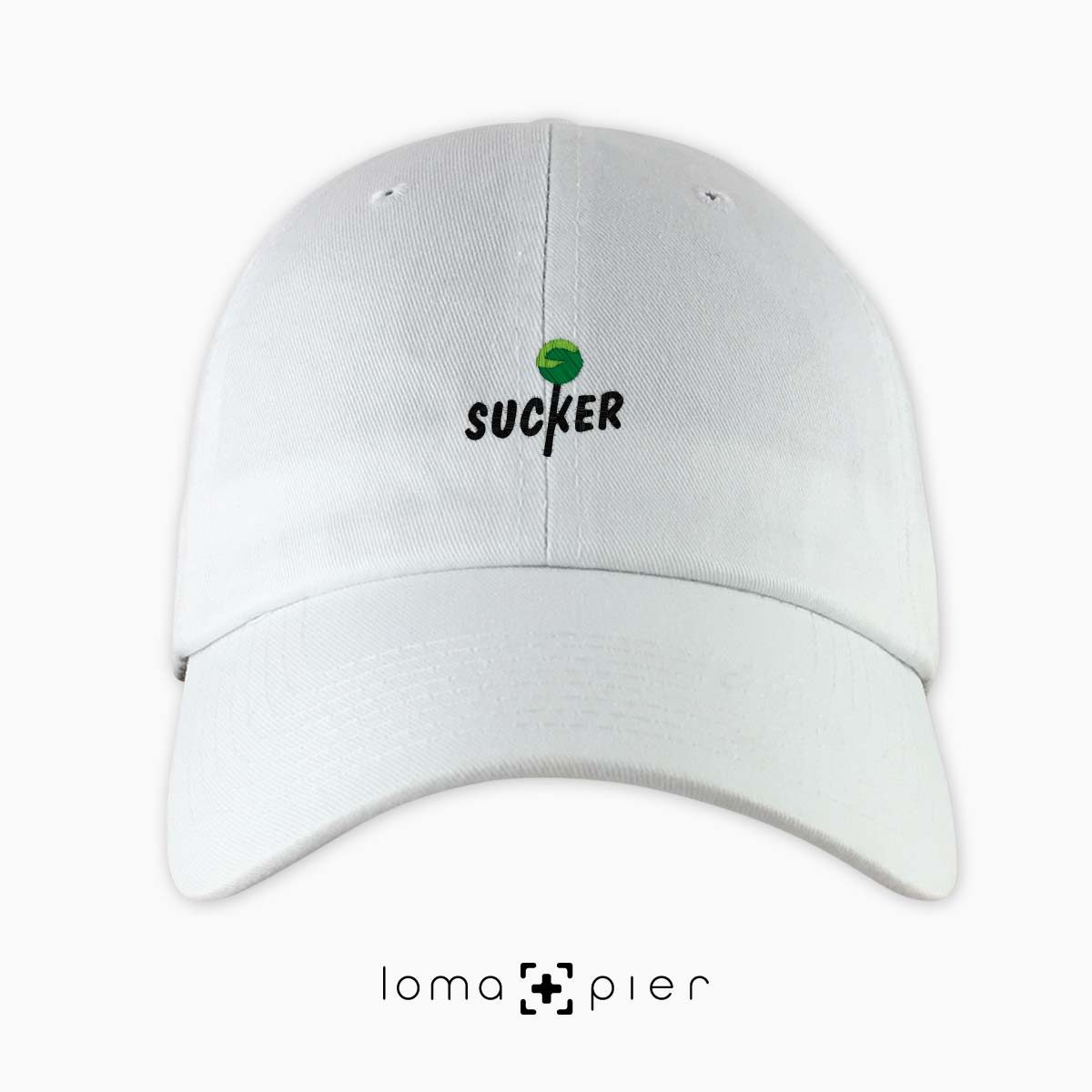 SUCKER icon embroidered on a white unstructured dad hat with multicolor thread by loma+pier hat store made in the USA