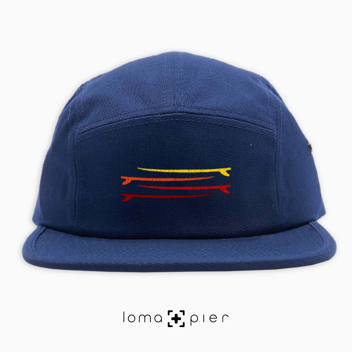 SURF STACK icon embroidered on a navy cotton 5-panel hat by loma+pier hat store