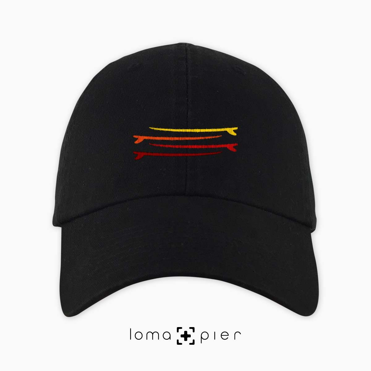 SURFBOARDS STACKED icon embroidered on a black dad hat by loma+pier hat store made in the USA