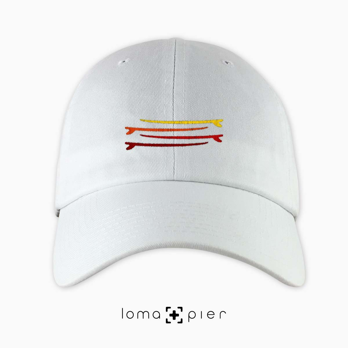 SURFBOARDS STACKED icon embroidered on a white dad hat by loma+pier hat store made in the USA