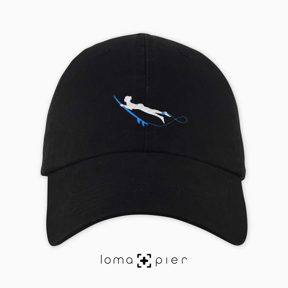 DUCK NAKED SURFER icon embroidered on a black dad hat by loma+pier hat store made in the USA
