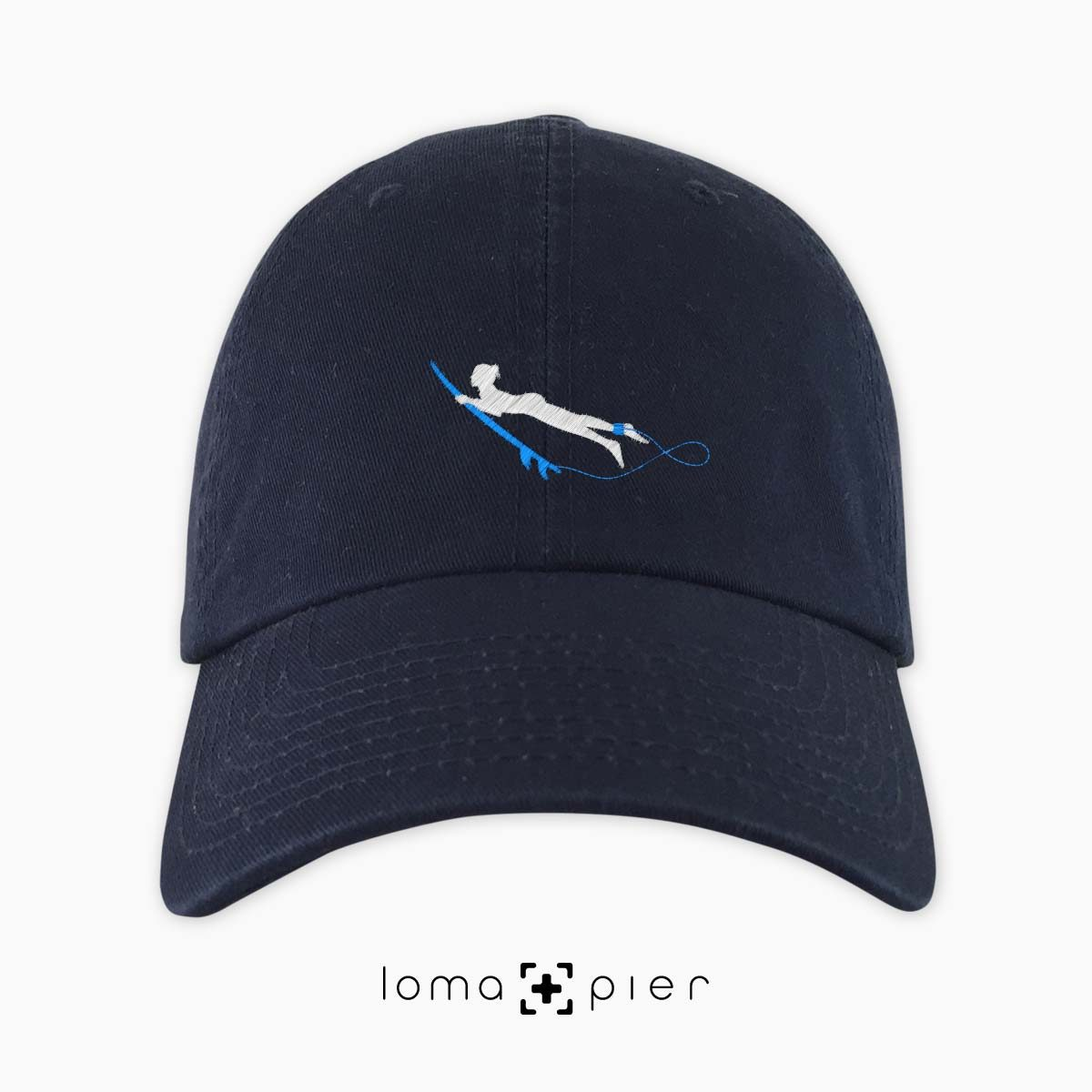DUCK NAKED SURFER icon embroidered on a navy blue dad hat by loma+pier hat store made in the USA