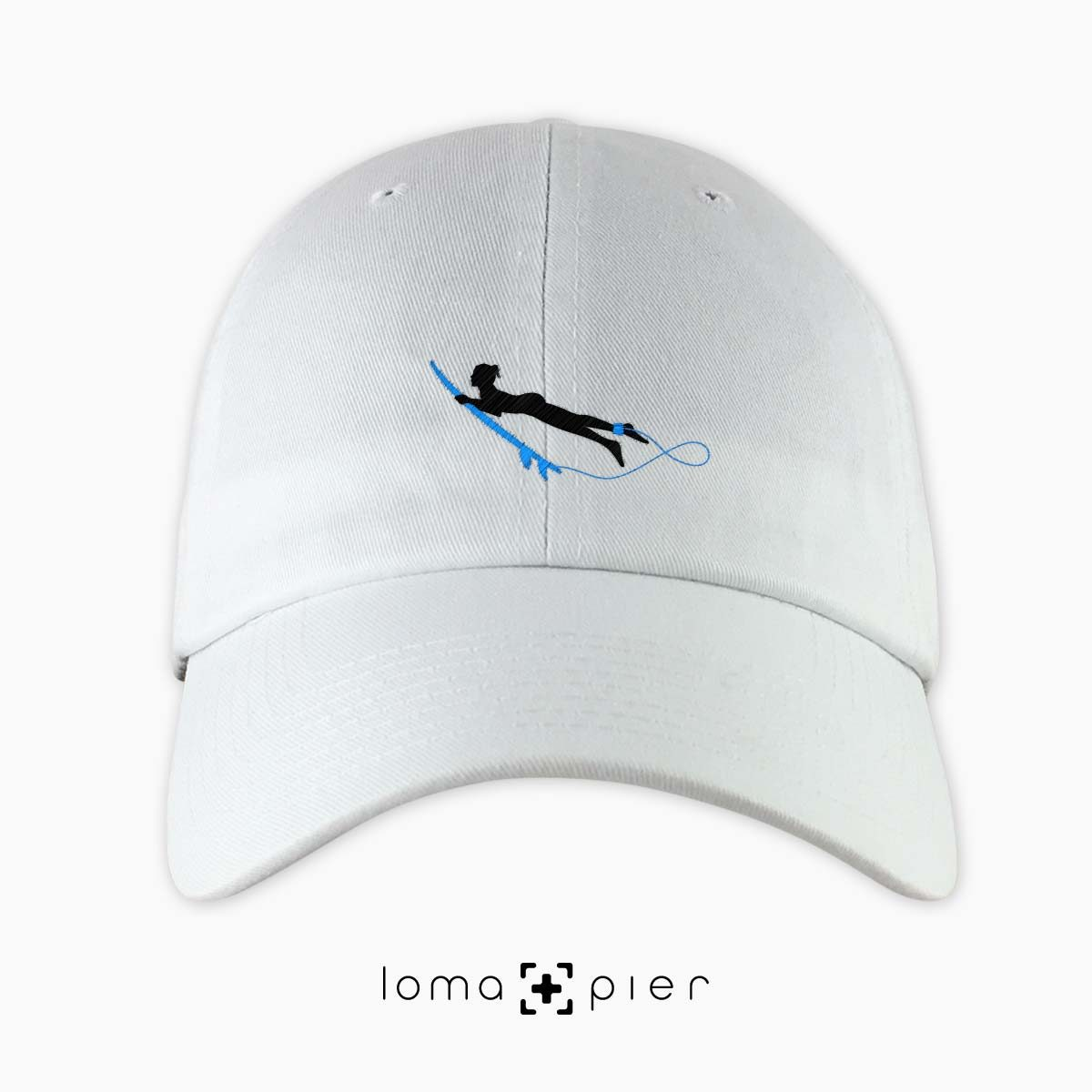 DUCK NAKED SURFER icon embroidered on a white dad hat by loma+pier hat store made in the USA