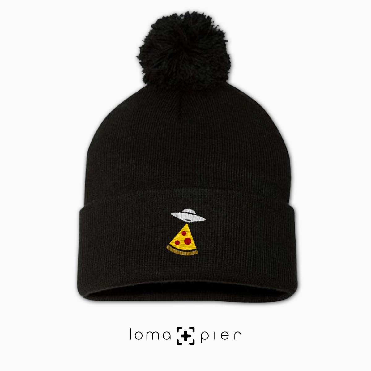 UFO PIZZA icon embroidered on a black pom pom beanie with multicolor thread by loma+pier hat store