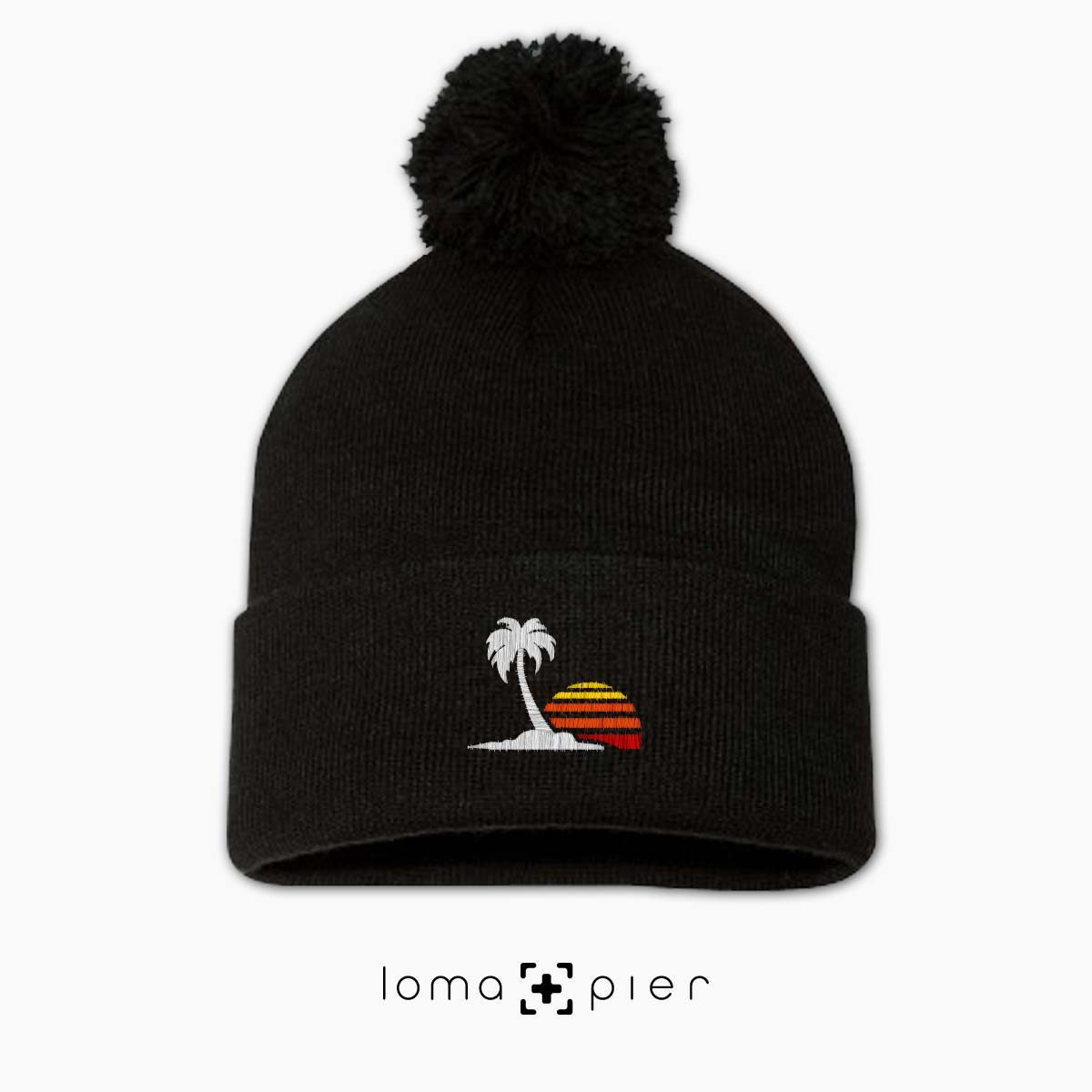 VENICE VIBES icon embroidered on a black pom pom beanie with multicolor thread by loma+pier hat store