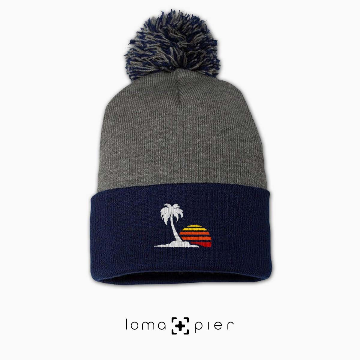 VENICE VIBES icon embroidered on a heather grey and navy blue pom pom beanie with multicolor thread by loma+pier hat store