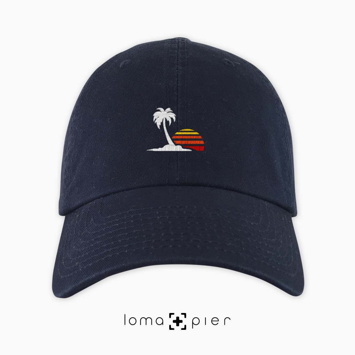 ​VENICE VIBES icon embroidered on a ​navy blue unstructured dad hat with multicolor thread by loma+pier hat store made in the USA