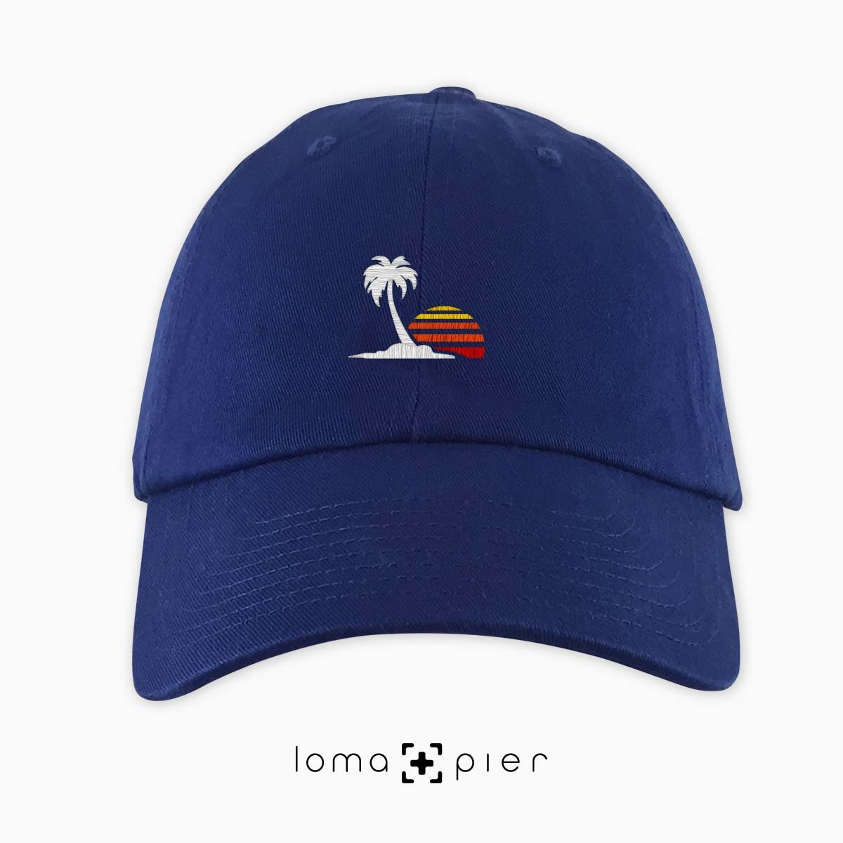 ​VENICE VIBES icon embroidered on a ​royal blue unstructured dad hat with multicolor thread by loma+pier hat store made in the USA