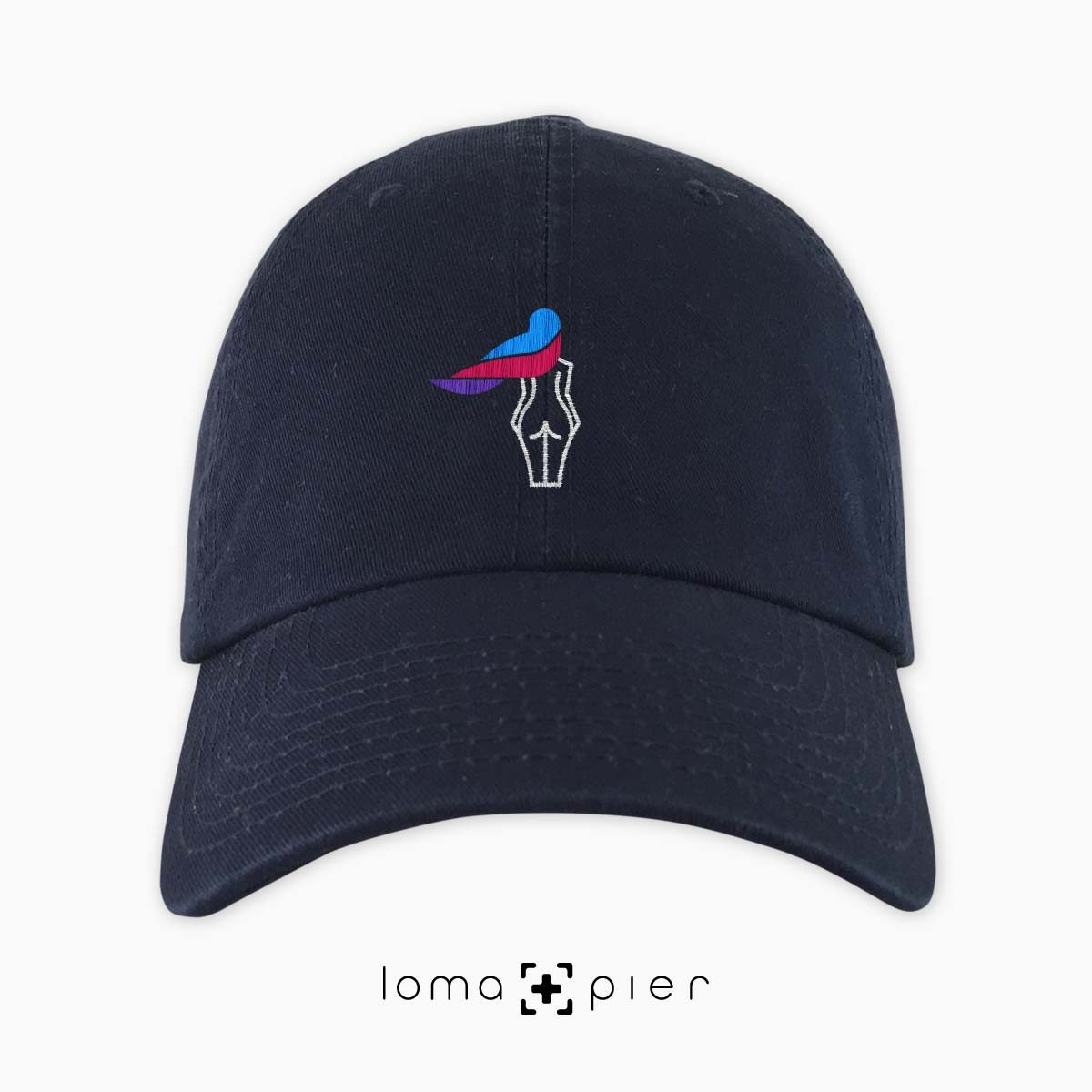 WAVY BEACH icon embroidered on a navy blue unstructured dad hat with multicolored thread by loma+pier hat store made in the USA