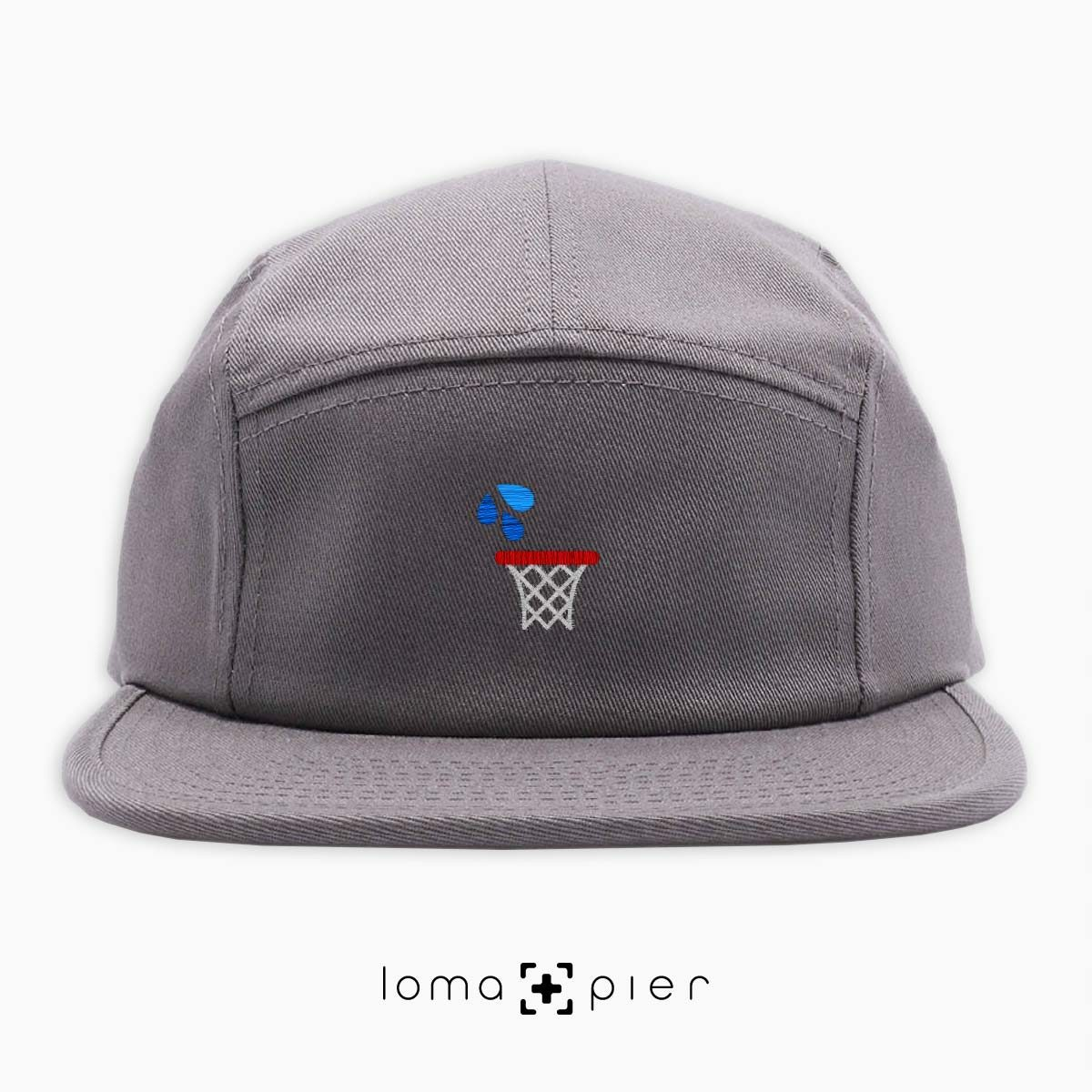 WET JUMPER basketball hoop icon embroidered on a grey cotton 5-panel hat by loma+pier hat store