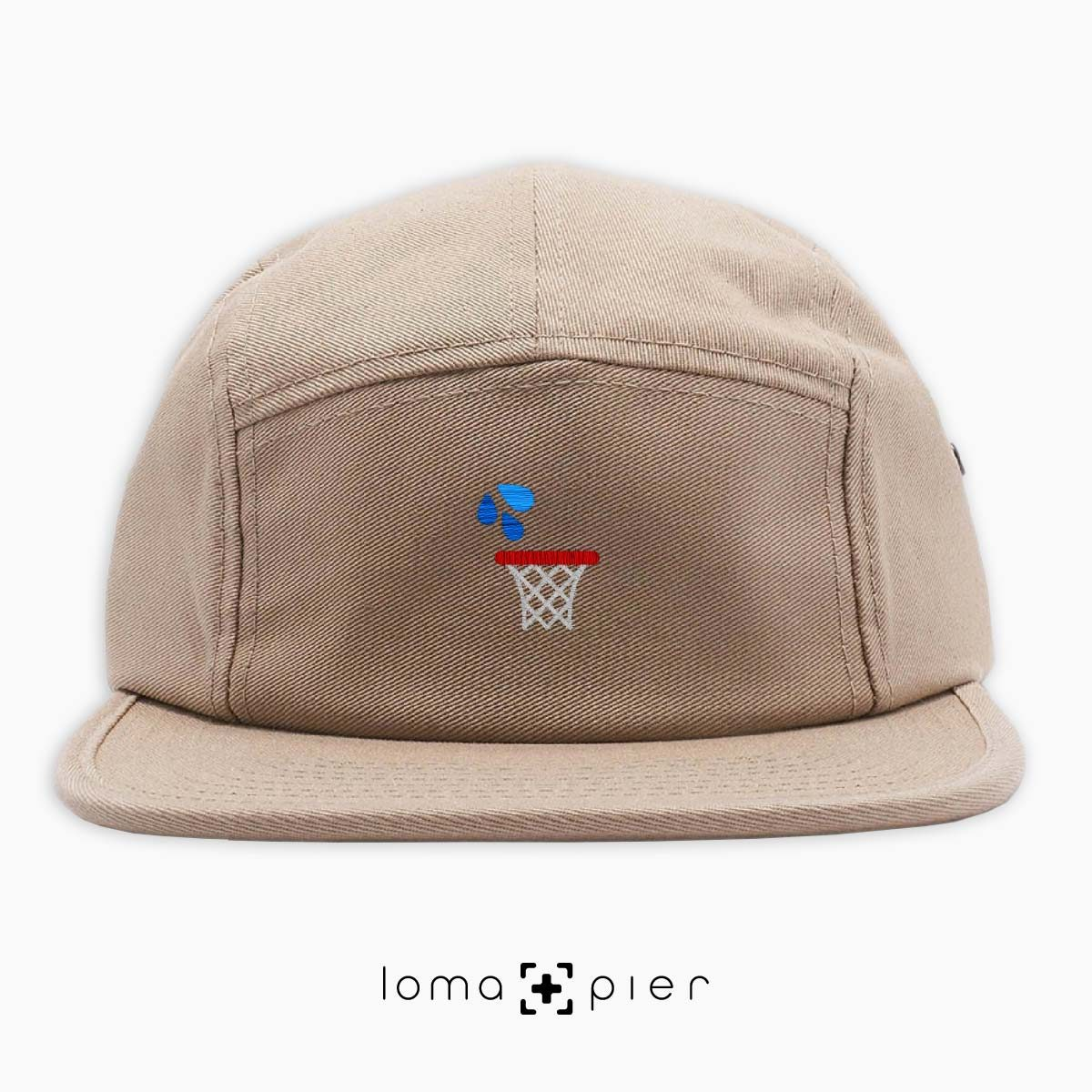 WET JUMPER basketball hoop icon embroidered on a khaki cotton 5-panel hat by loma+pier hat store
