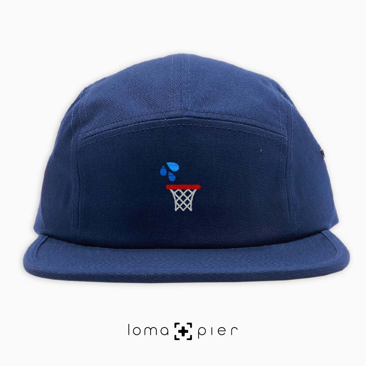 WET JUMPER basketball hoop icon embroidered on a navy blue cotton 5-panel hat by loma+pier hat store