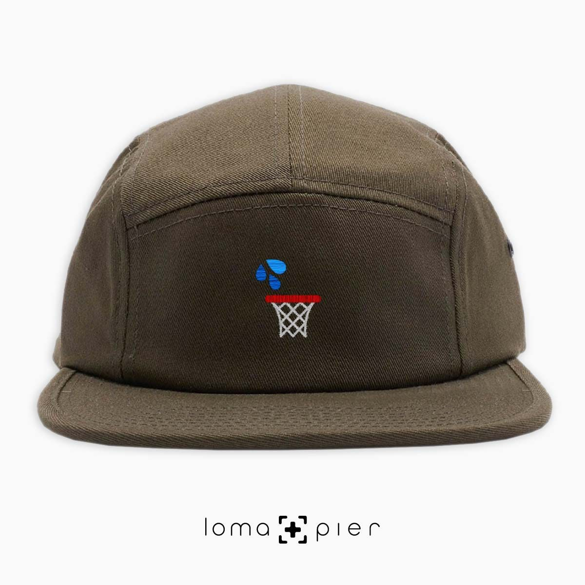 WET JUMPER basketball hoop icon embroidered on an olive green cotton 5-panel hat by loma+pier hat store