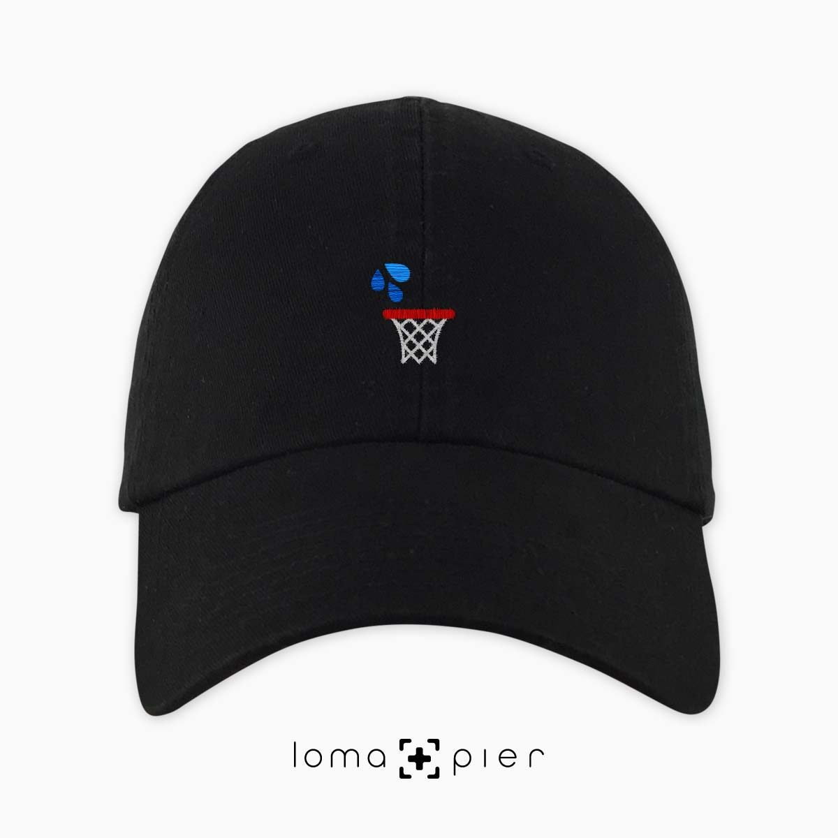 WET JUMPER basketball hoop icon embroidered on a black unstructured dad hat by loma+pier hat store made in the USA
