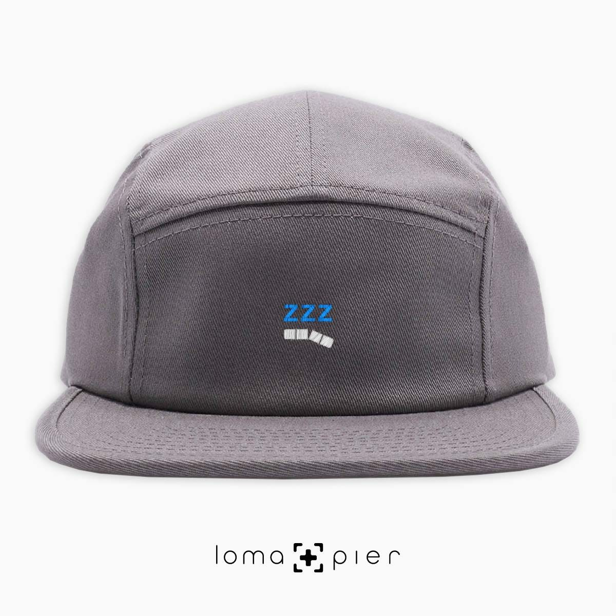 ZZZ-ANNY icon embroidered on a grey cotton 5-panel hat with white and sky blue thread by loma+pier hat store
