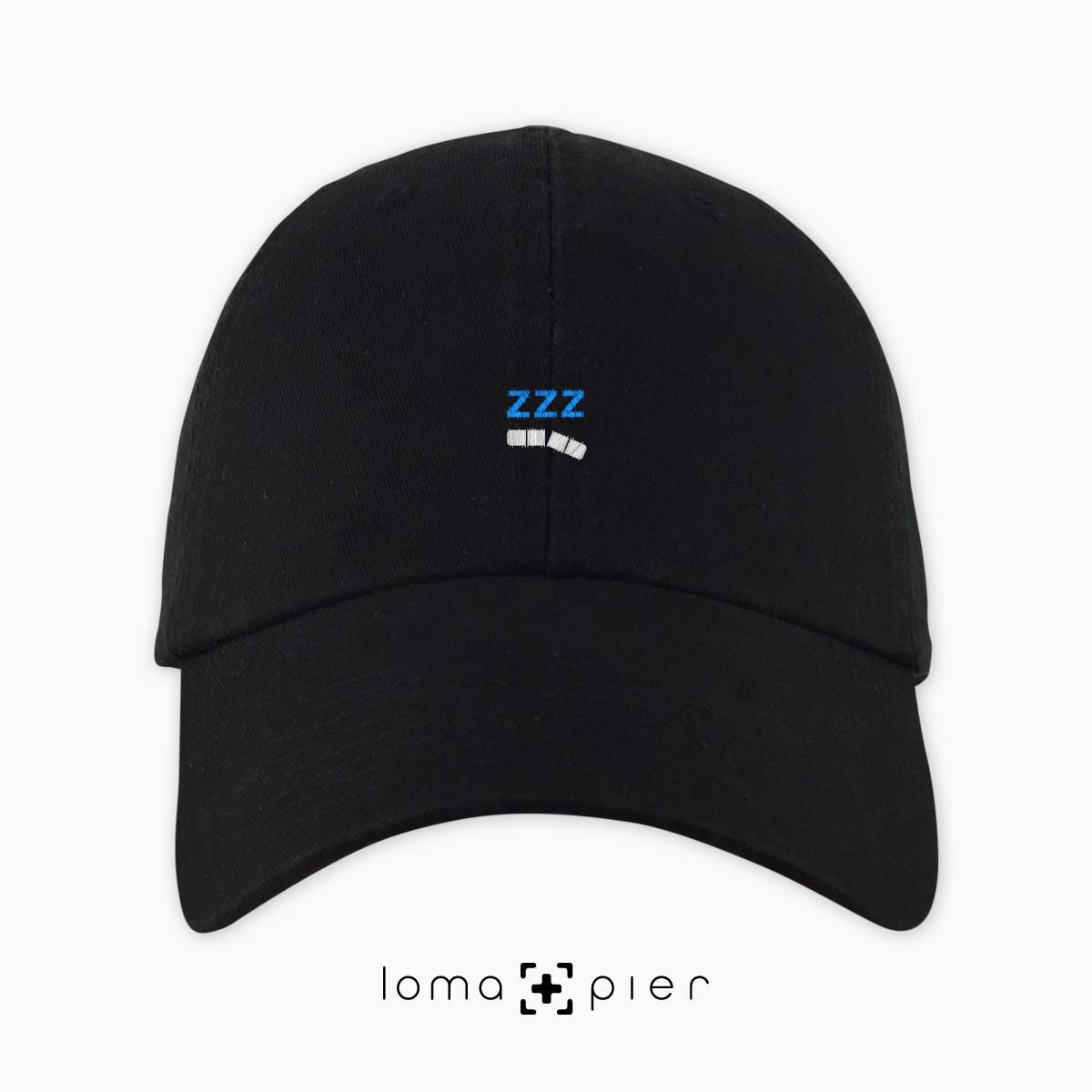 ZZZ-ANNY icon embroidered on a black unstructured dad hat with white and sky blue thread by loma+pier hat store made in the USA