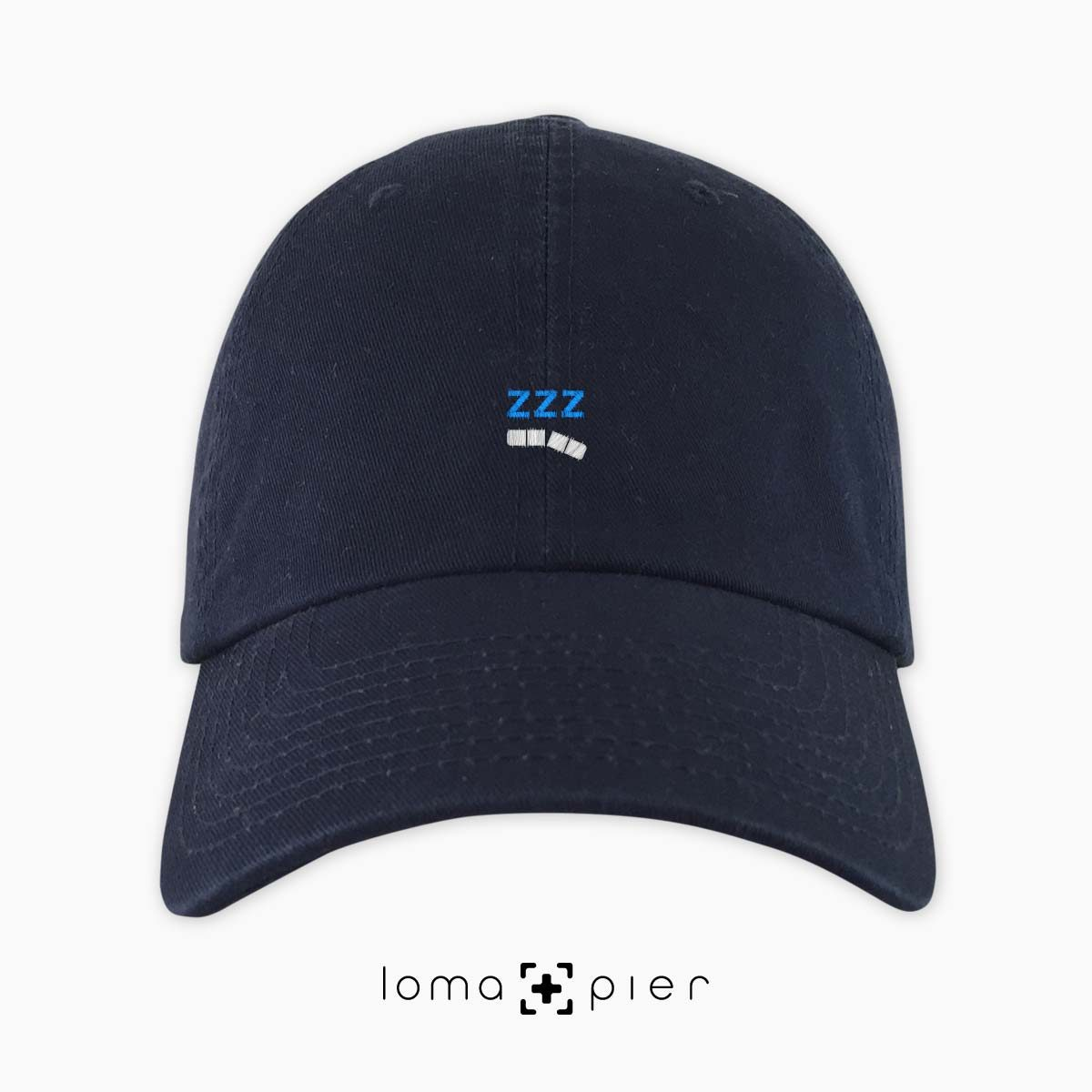ZZZ-ANNY icon embroidered on a navy blue unstructured dad hat with white and sky blue thread by loma+pier hat store made in the USA
