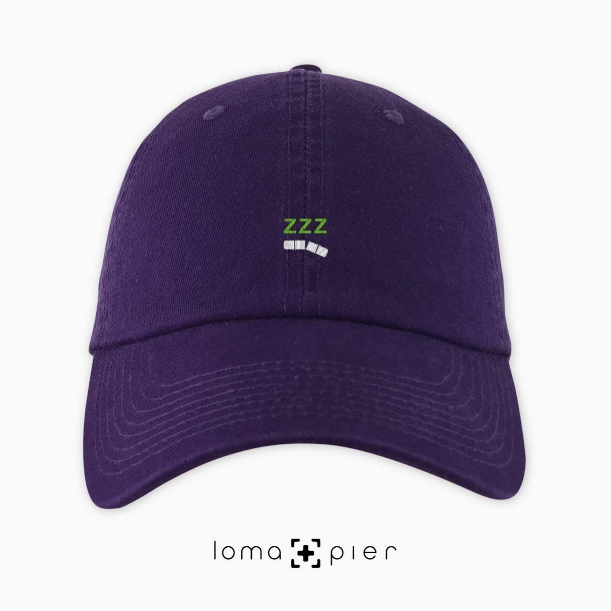 ZZZ-ANNY icon embroidered on a purple unstructured dad hat with white and lime green thread by loma+pier hat store made in the USA